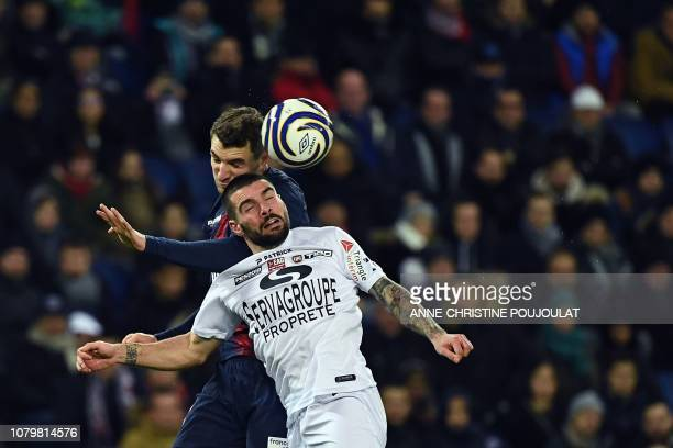 Guingamp's Portuguese defender Rebocho jumps for the ball with Paris SaintGermain's Belgian defender Thomas Meunier during the French League Cup...