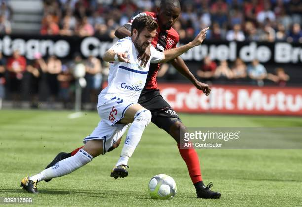 Guingamp's Senegalese midfielder Moustapha Diallo fights for the ball with Strasbourg's French midfielder Benjamin Corgnet during the French Ligue 1...
