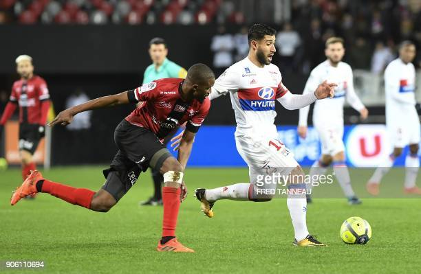 Guingamp's Senegalese midfielder Moustapha Diallo vies for the ball with Lyon's French midfielder Nabil Fekir during the French L1 football match...