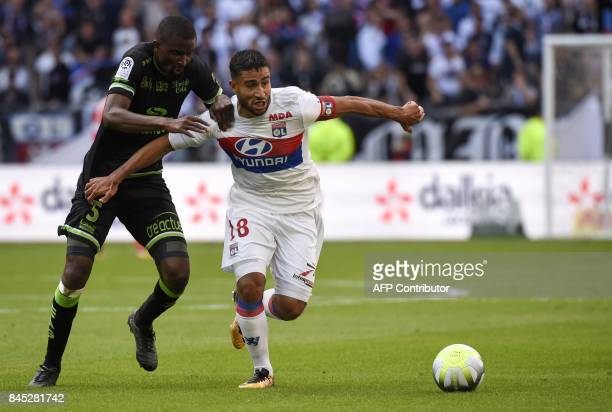 Guingamp's Senegalese midfielder Moustapha Diallo vies with Lyon's French midfielder Nabil Fekir during the French L1 football match Lyon vs Guingamp...
