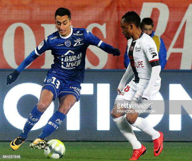 Guingamp's South African midfielder Lebogang Phiri vies with Troyes' midfielder SaîfEddine Khaoui during the French L1 football match between Troyes...
