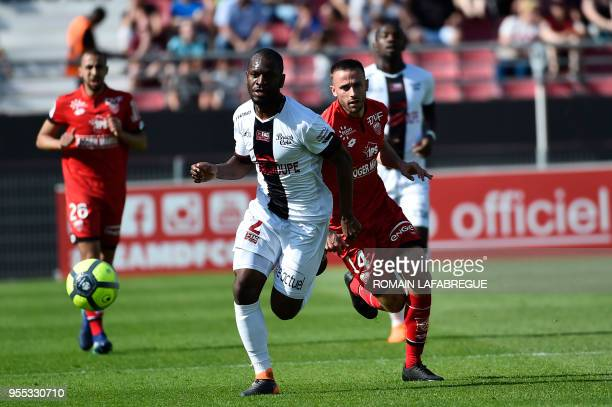 Guinguamp Congolese defender Jordan Ikoko is challenged by Dijon's French midfielder Jordan Marie during the French L1 football match between Dijon...