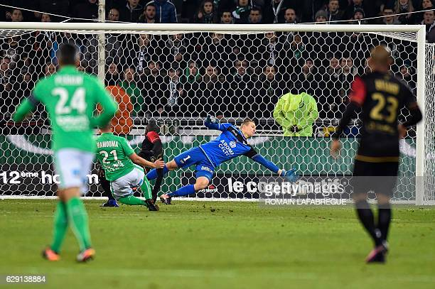 Guinguamps Swedish goalkeeper Karl-Johan Johnsson concedes a goal during the French L1 football match between Saint-Etienne and Guinguamp at the...
