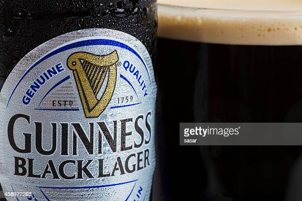 guinness black lager - guinness stock photos and pictures