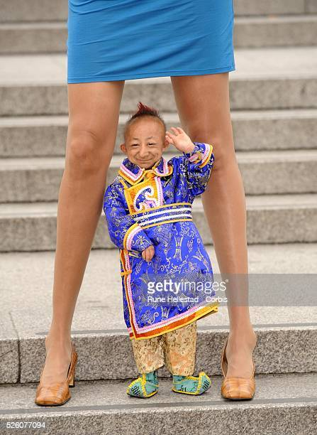 Guinness Book Of Records photocall with the worlds shortest man He Pingping and the woman with the longest legs Svetlana Pankratova at Trafalgar...