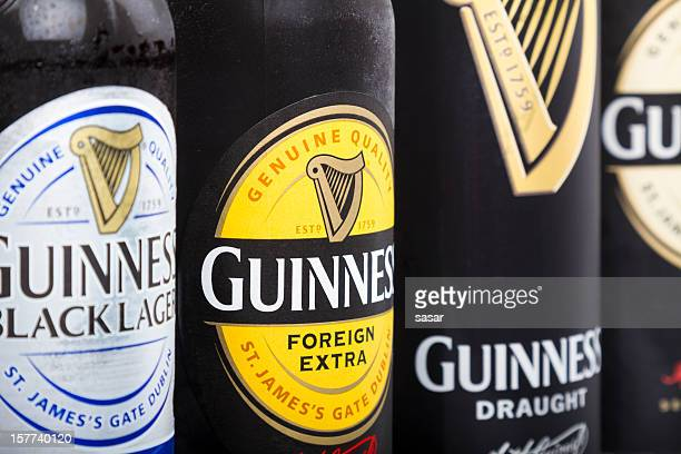 guinness draught/stout - guinness stock photos and pictures