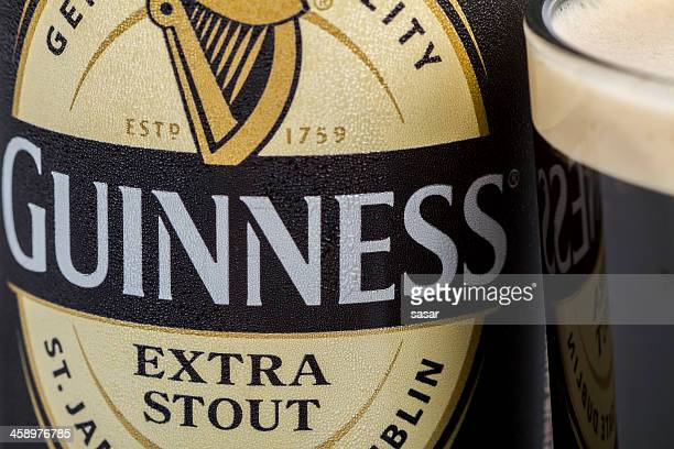 guinness extra stout - guinness stock photos and pictures