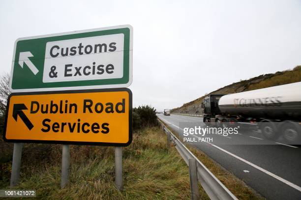 A Guinness lorry passes a sign on a main road outside Newry Northern Ireland on November 14 2018 pointing towards an old customs and excise station...