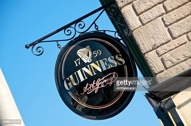 guinness sign - guinness stock photos and pictures