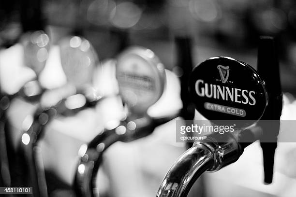 guinness tap at an english pub - guinness stock photos and pictures