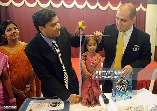 Guinness World Records Adjudicator Rob Molloy and doctor Manoj Pahukar measure Jyoti Amge during a news conference in Nagpur on December 16 2011 Amge...
