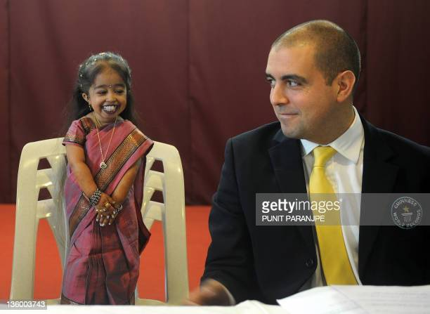 Guinness World Records adjudicator Rob Molloy and Jyoti Amge attend a news conference in Nagpur on December 16 2011 Amge was officially announced by...