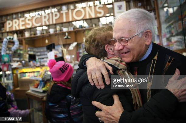 Guiseppe Giangregorio embraces longtime customer and friend Emily Piccolo at the Green Cross Pharmacy in the North End of Boston on Feb 28 2019...