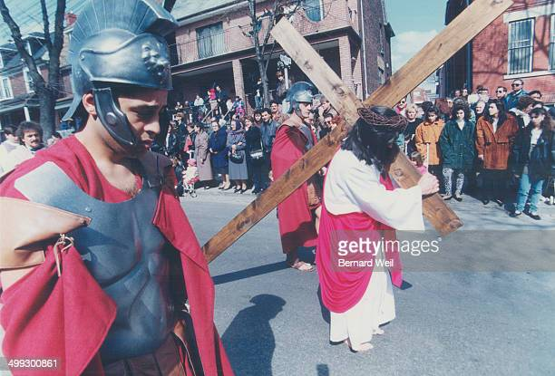 Guiseppe Ranti carries a cross
