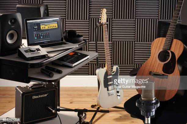 Guitar and audio hardware photographed for a feature on recording your own music including an Apple Macbook Universal Audio Apollo Twin interface and...