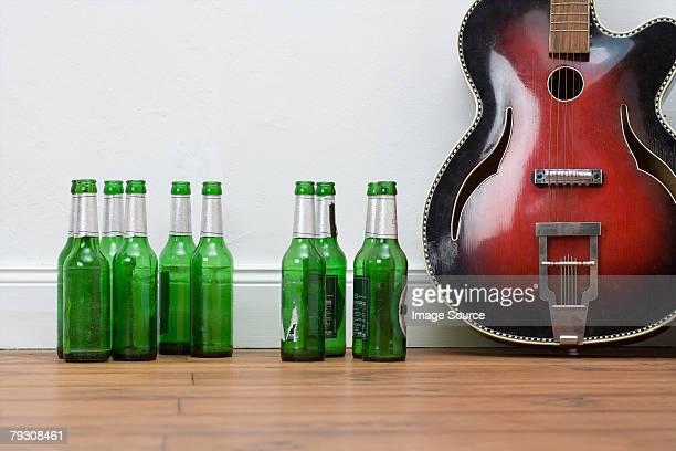 Guitar and beer bottles