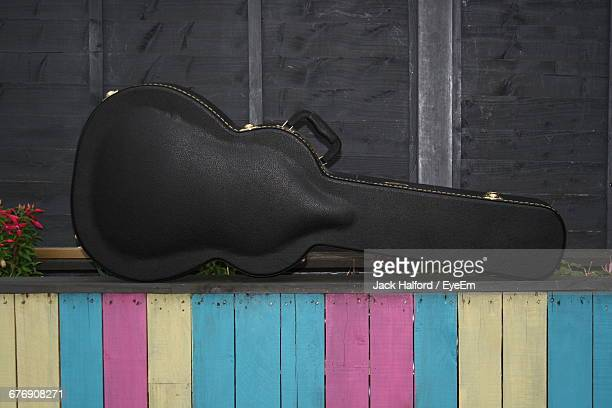 guitar case on planter - guitar case stock pictures, royalty-free photos & images