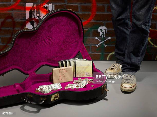 guitar case on street with cds for sale - guitar case stock pictures, royalty-free photos & images