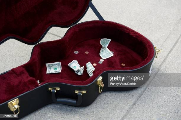 guitar case with cash - guitar case stock pictures, royalty-free photos & images