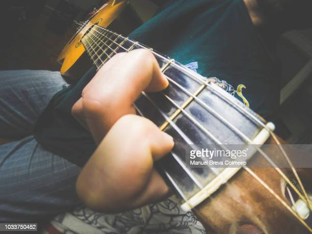 guitar chords - acoustic music stock pictures, royalty-free photos & images