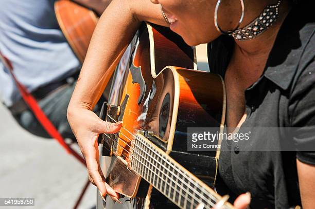 Guitar instructors give guitar lessons to members of the public during Make Music Day Guitar Lessons/Mass Appeal in Time Square on June 21 2016 in...