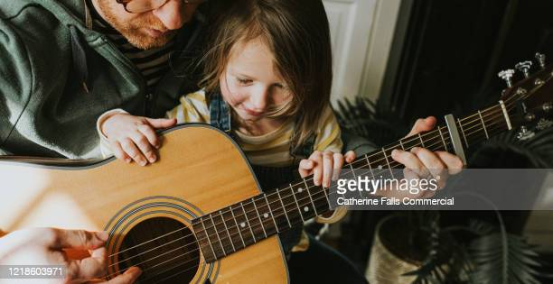 guitar lesson - songwriter stock pictures, royalty-free photos & images