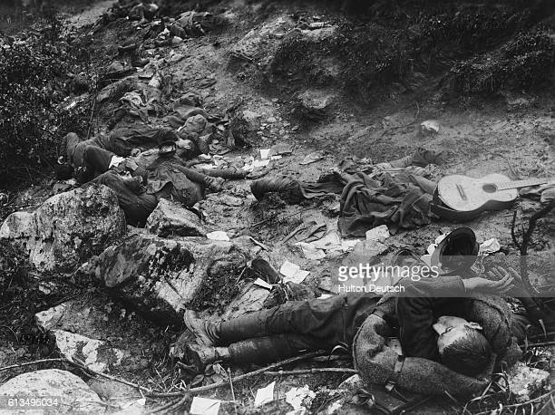 Guitar lies beside the bodies of Italian soldiers caught by a surprise Austrian attack, in the mountains near Cividale, Italy, during World War I. |...