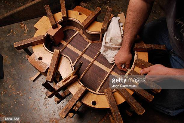 guitar making - instrument maker stock photos and pictures