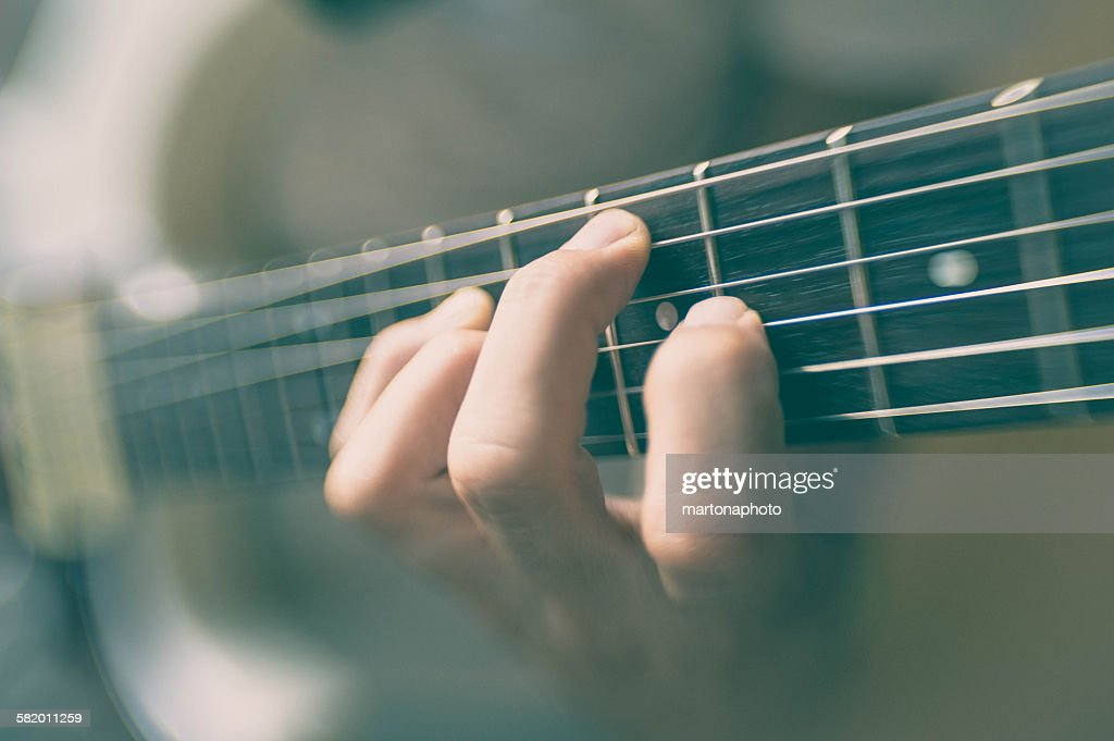 Guitar neck, finger guitarist, and speed : Foto de stock