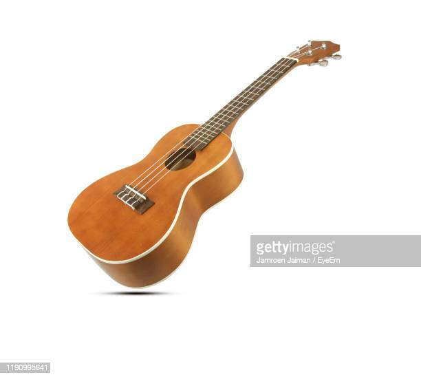 guitar on white background - acoustic guitar stock pictures, royalty-free photos & images