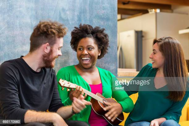 guitar party group of friends - ukulele stock pictures, royalty-free photos & images