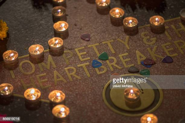 Guitar picks lie scattered across a makeshift memorial at the Tom Petty and the Heartbreakers star on The Hollywood Walk of Fame on October 2 2017 in...