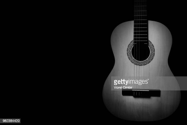 b&w guitar - classical guitar stock photos and pictures