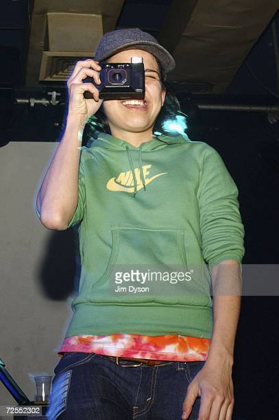 Guitar player Ana Rezende of Sao Paulo electropop sextet CSS takes a photo of the audience at the Scala in King's Cross on November 14 2006 in London...