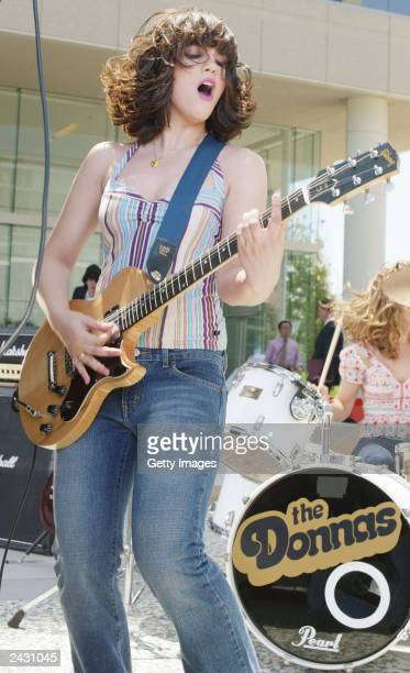 Guitar player for The Donnas Allison Robertson peforms while shooting the bands video Too Bad About Your Girl July 6 2003 in Los Angeles California