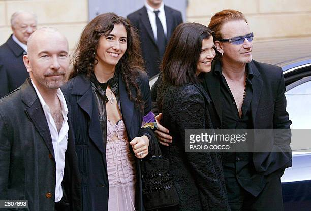 Guitar player for the rock group U2 The Edge poses flanked by his wife Morleigh Steinberg and Irish singer Bono with his wife Alison Steward after...