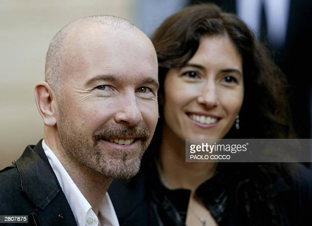 Guitar player for the rock group U2 The Edge smiles flanked by his wife Morleigh Steinberg after attendin the wedding of famous Italian tenor Luciano...