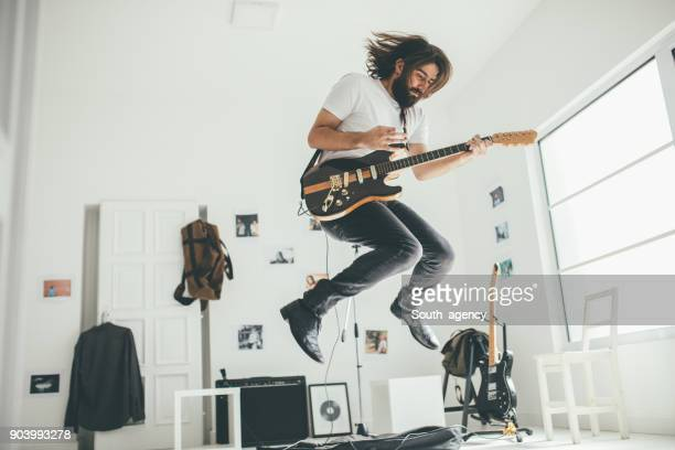 guitar player having fun - musician stock pictures, royalty-free photos & images