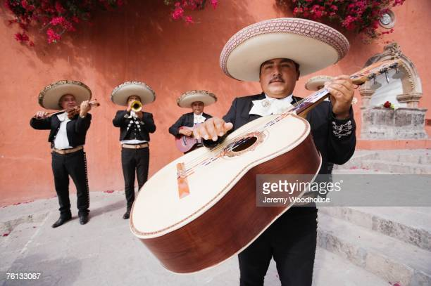 guitar player in mariachi band - mariachi stock pictures, royalty-free photos & images