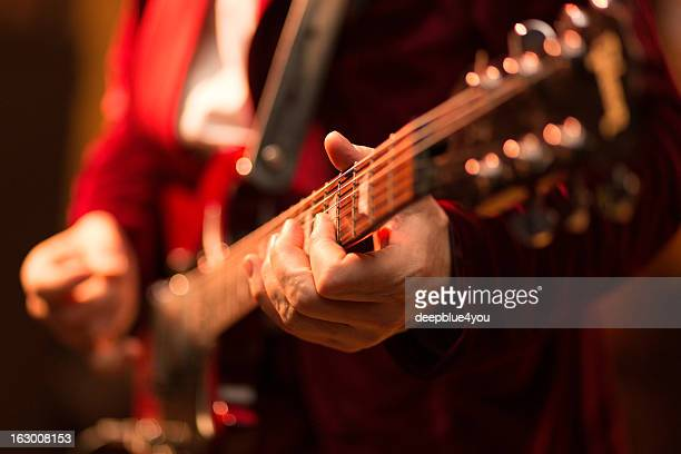 guitar player on stage - blues music stock pictures, royalty-free photos & images