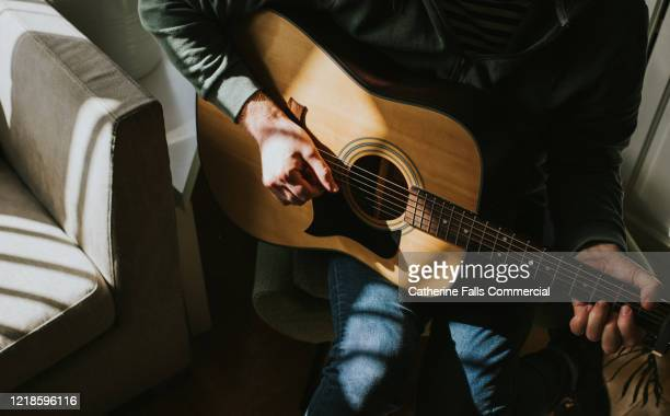 guitar player - songwriter stock pictures, royalty-free photos & images