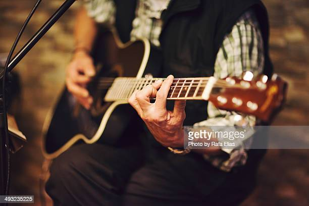 guitar player - acoustic guitar stock pictures, royalty-free photos & images