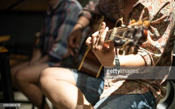 guitar player playing song outdoor - acoustic music stock pictures, royalty-free photos & images