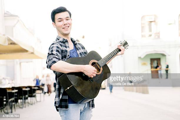 Guitar Player Singing Outdoors
