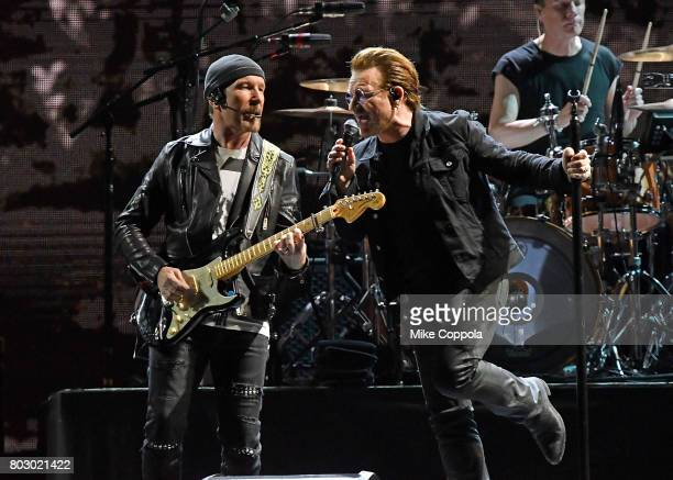 Guitar player The Edge and Singer Bono of the band U2 perform during U2 Joshua Tree Tour 2017 at MetLife Stadium on June 28 2017 in East Rutherford...