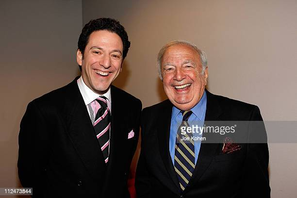 Guitar Players Bucky Pizzarelli and his son John Pizzarelli pose for a photo at The Duke Jazz Talks at Bruno Walter Auditorium New York Public...