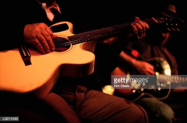 guitar playing - nashville stock pictures, royalty-free photos & images