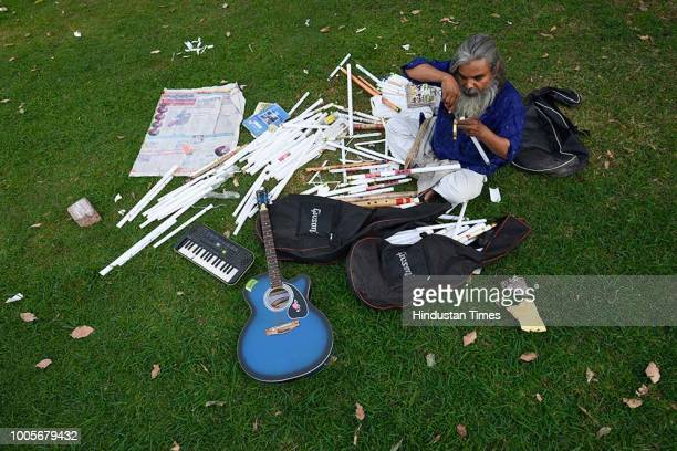 Guitar Rao makes flutes with electrical plastic pipes and later sell them among music learning enthusiasts at Vijay Chowk lawns, on May 22, 2018 in...