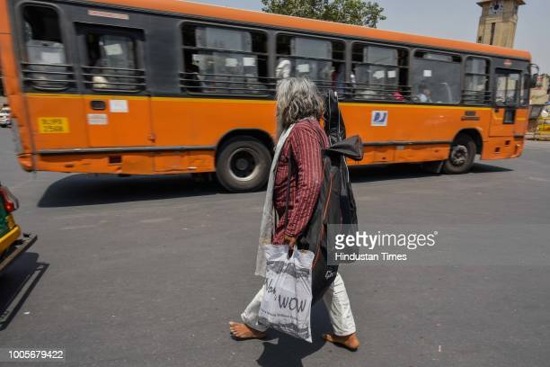 Guitar Rao makes his way through a road near Ajmeri Gate to have a 10 Rupee lunch on May 22, 2018 in New Delhi, India. A former civil engineer, Rao...