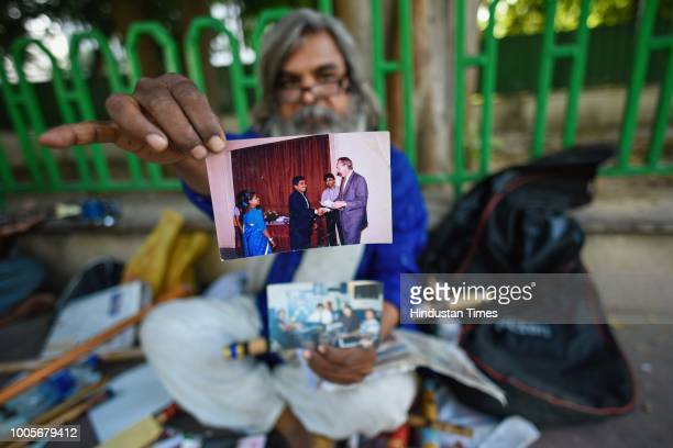 Guitar Rao shows his old photograph, in which he is receiving the degree of Civil Engineering, outside Andhra Bhawan, on May 22, 2018 in New Delhi,...